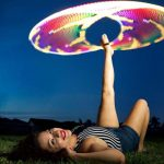Ashley Elise Hooping in the grass with LED hula hoop